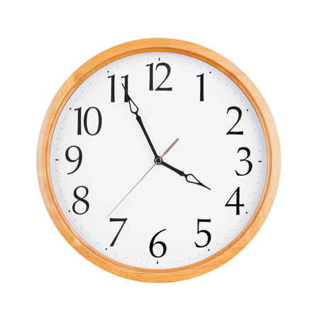 12 hour: Round clock shows five minutes to four