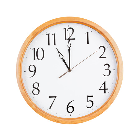 twelve: Exactly twelve oclock on a large round dial Stock Photo