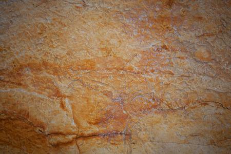 hardwearing: Stone surface of orange color with cracks