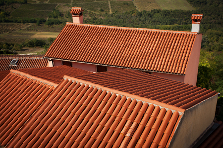 Houses with roofs covered with clay roof tiles