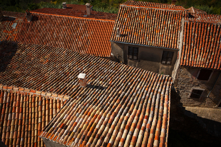 Houses with roofs covered with old tiles Stock Photo