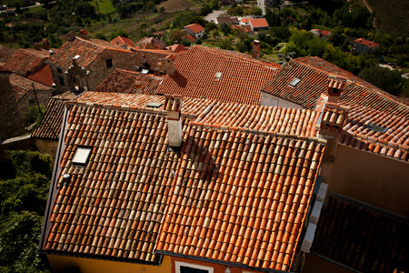 Several houses with roofs covered with tiles
