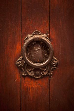 doorhandle: Old copper doorhandle on a wooden door