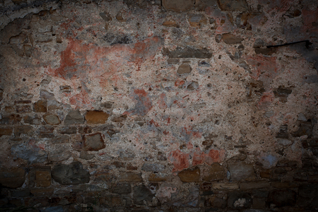 plastered wall: Vintage red plastered wall from different stones