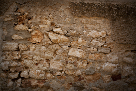 firmness: Fragment of the old city wall of bricks Stock Photo
