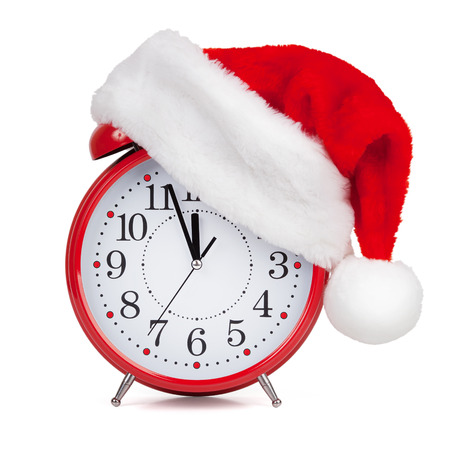 Hat Santa Claus put on a red alarm clock