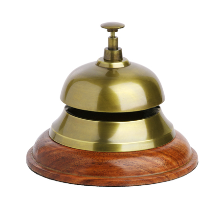 Brass bell for concierge on white background Stock Photo - 119846623