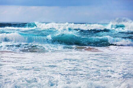 Raging atlantic ocean with waves rolling ashore