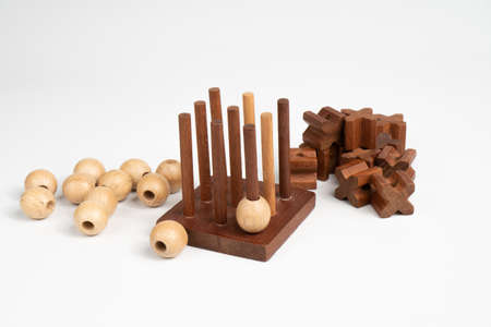 Start playing tic tac toe. Three-dimensional wooden voluminous field for tic-tac-toe competition.