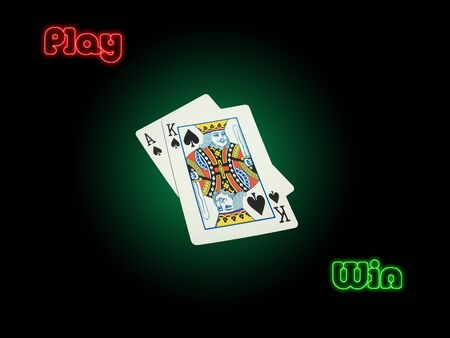 suited high cards ace of spades and king of spades on poker green background vignetted. red play and green win with neon effect on a black background. symbolizes compitition, success, winning, luck...