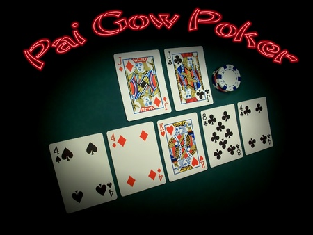 A Pai Gow Poker hand is spotlighted against a poker green background with a glowing red neon headline. The hand showing is a Pair-Of-Jacks on top and Three-Fours on bottom... a very good hand and hard to beat. Pai Gow Poker is also called Double-Hand Poke