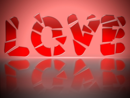 The word LOVE in red glass letters, shattered. Suggests broken heart, lost love... photo
