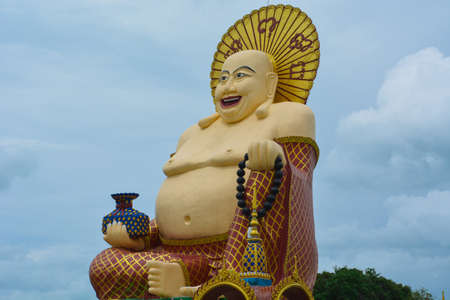 glut: Smiling chubby statue of the deity in Asia