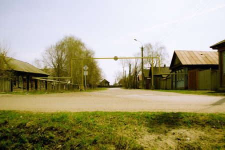 somewhere: Gasified street of wooden houses somewhere in the Russian province