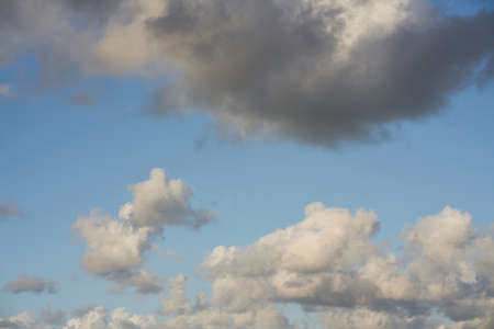beautiful white cloud formation in bright blue sky as background Stock Photo