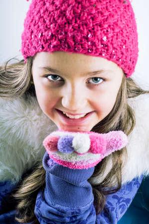 Little Girl Sending winter kisses