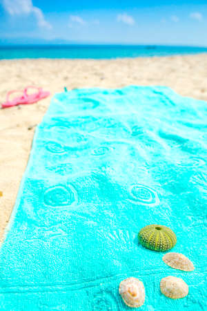 blue towel on the white sand sand  Stock Photo