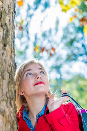 woman lookin up with shopping bag Stock Photo