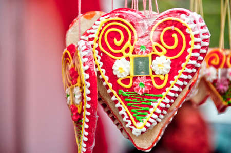 Sweetly candies named Leceder hearts with mirror in the center hung up on tiny thread Stock Photo