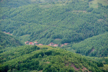 Aerial view on small village somewhere in the forest Stock Photo