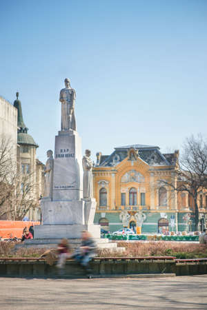 Sunny afternoon on public square in Subotica with benches in the circle and the monument of emperor in the middle Stock Photo