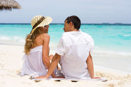 A happy young couple on a beach Stock Photo - 8558043