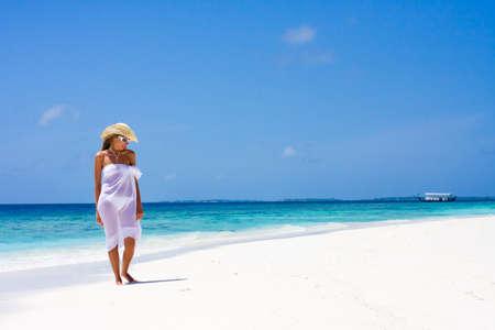 Lady in a bikini on a tropical beach Stock Photo - 8606391