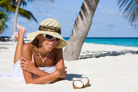 A lady is relax on a tropical beach photo