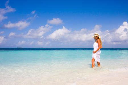 Lady in bikini on a tropical beach photo