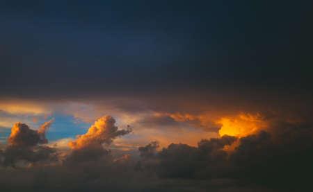 spellbinding: red-orange sunset on the tightened sky rain clouds.