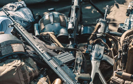 automatic machine, machine gun, helmet, body armor piled in a heap lie on the ground. 写真素材