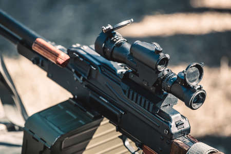 gun sight: Machine gun with optical sight closeup.
