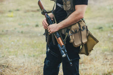 Soldier with a gun in the hands of the patrol area.