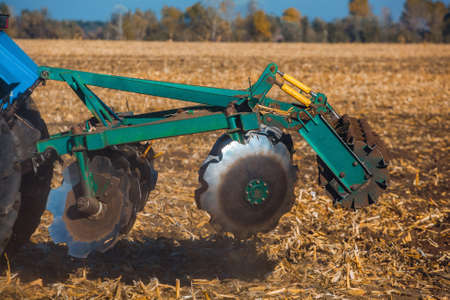 Part of the cultivator, steel, round discs in a row. Close-up. The work of agricultural hinery. Stock Photo