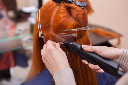 Hair extensions procedure hairdresser does hair extensions to the hairdresser does hair extensions to a young red haired girl in a pmusecretfo Image collections