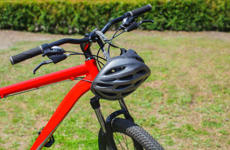 The front part of the bicycle is red-wheel, wheel and frame close-up.