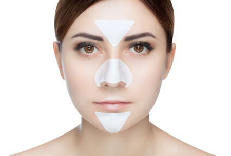 Portrait of a beautiful girl with a mask from acne on the nose and t-zone. Stockfoto