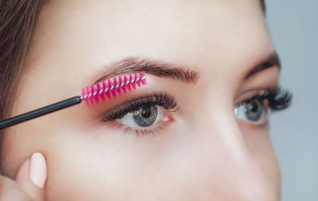 Beautiful woman with long eyelashes in a beauty salon.