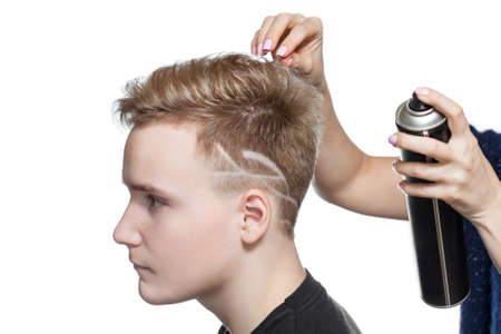 Mens creative haircut in the beauty salon. Hair care and hair styling.