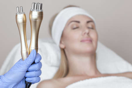 Portrait of woman getting rf-lifting procedure in a beauty parlour Reklamní fotografie