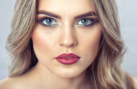Portrait of a woman with beautiful make-up and hairstyle. Professional makeup and skin care.