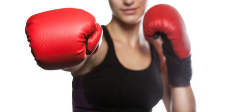 A beautiful sportswoman is boxing in the gym. Doing sports and sports life. Stock fotó