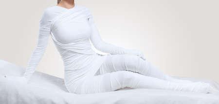 The cosmetologist wraps the leg of the customer. Anti-cellulite procedure-STYX wrap. Stock fotó