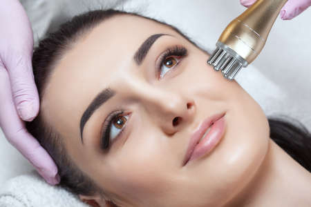 The cosmetologist does rf-lifting. Rf lifting procedure in a beauty salon.
