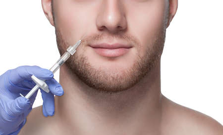 Mens cosmetology. Beautician makes a man a rejuvenation injection procedure on his face.