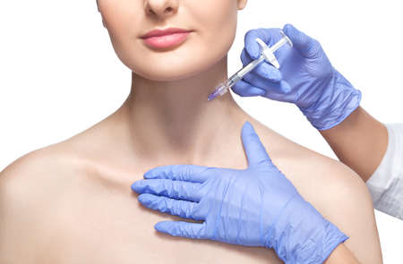 Cosmetologist does prp therapy anti wrinkle and aging skin on the neck of a beautiful woman in a beauty salon. Cosmetology concept.
