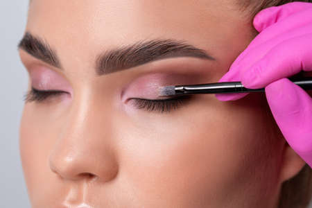 Eyes and eyebrows close up. Portrait of a beautiful teenage girl with beautiful makeup and healthy clean skin. Make-up artist does eyes make-up.Makeup and cosmetology concept.