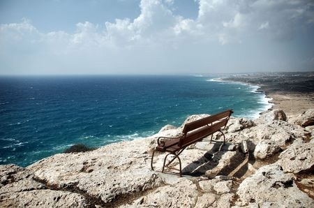 Lonely bench on Kavo Greko in Cyprus photo