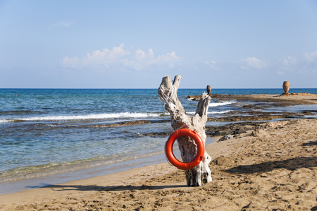 Lifebuoy on a beach Stock Photo
