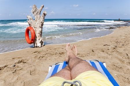 Man rest on the beach